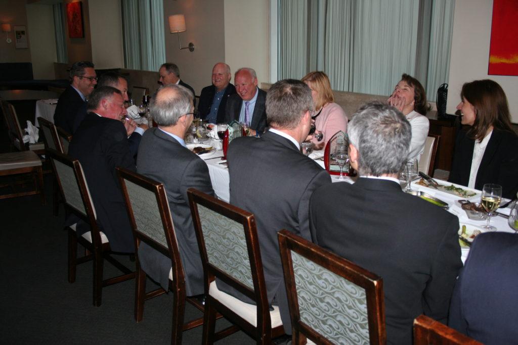 Sen. Dianne Feinstein, center, during the spring 2016 board Salon Dinner. Opposite her is Sen. Richard Burr. The senators were the ranking member and chairman, respectively, of the Senate Intelligence Committee.